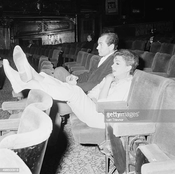 American actress and singer Judy Garland and her partner Mark Herron at the London Palladium UK 8th November 1964 Garland is rehearsing for a concert...