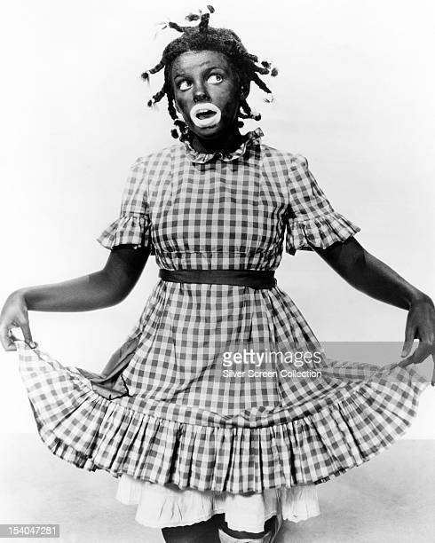 American actress and singer Judy Garland in blackface as Judy Bellaire in 'Everybody Sing' 1938
