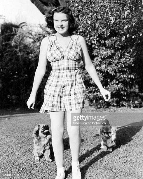 American actress and singer Judy Garland with two pet dogs circa 1940