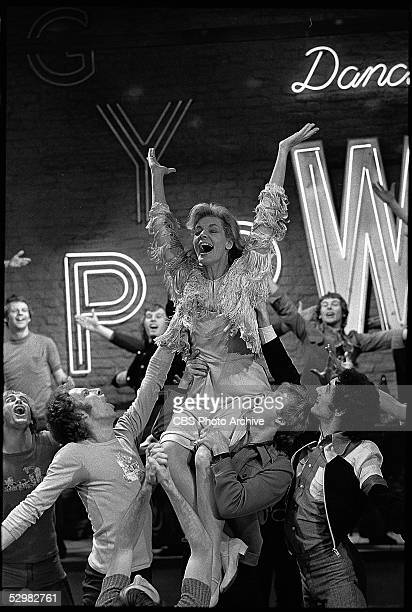 American actress and singer Lauren Bacall is lifted up by a group of male singers in a still from the television musical 'Applause' 1973 The...