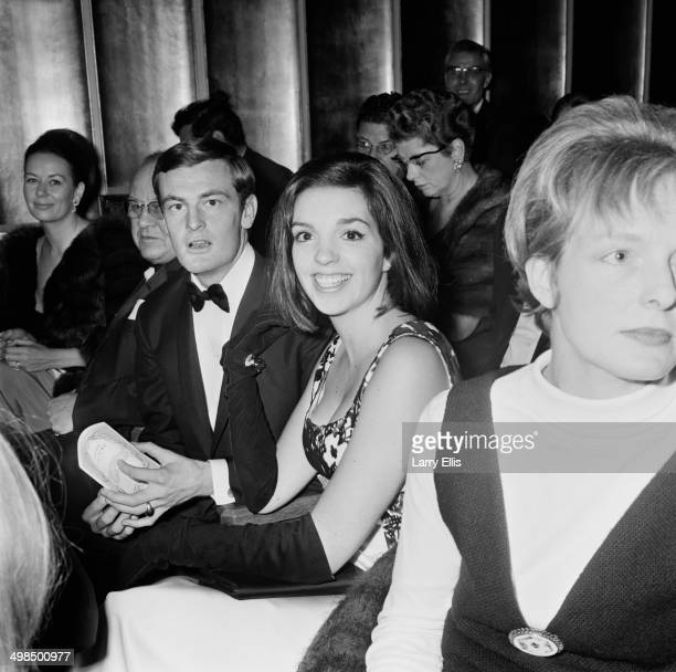 American actress and singer Liza Minnelli and her partner Australian songwriter Peter Allen attend the opening night of the musical 'High Spirits' at...