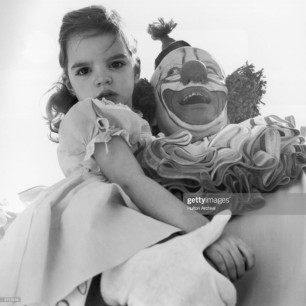 American actress and singer Liza Minnelli as a child in the arms of Bozo the Clown at a children's Easter party in Hollywood