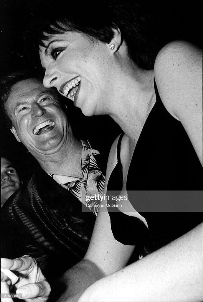 American actress and singer, Liza Minnelli (R) with former husband Australian songwriter and entertainer <a gi-track='captionPersonalityLinkClicked' href=/galleries/search?phrase=Peter+Allen+-+Musician&family=editorial&specificpeople=12535589 ng-click='$event.stopPropagation()'>Peter Allen</a> (1944-1992) at a record release party at Red Zone in November 1989 in New York City, New York.