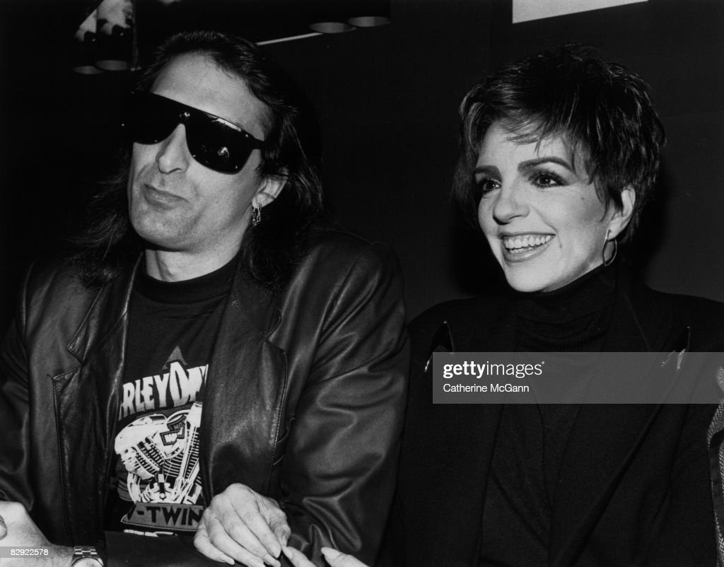 American actress and singer, Liza Minnelli (R) with husband, sculptor Mark Gero, at a record release party at Red Zone in November 1989 in New York City, New York.