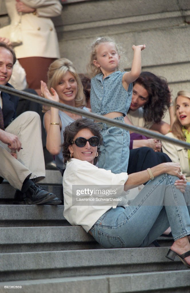 American actress and TV presenter Marla Maples (waving, left) with her mother, Laura Ann Locklear (1940 - 2014, front) and daughter, Tiffany Trump, on the set of Bryan Spicer's comedy film, 'For Richer Or Poorer', New York City, USA, 6th July 1997. Maples is the wife of American businessman Donald Trump.