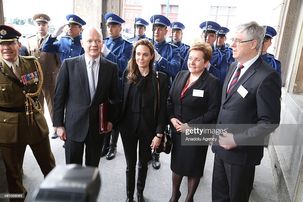 American actress Angelina Jolie (L2) and British FM William Hague (L) attend the conference entitled Prevention of sexual violence in conflict-empowerment security forces in peace support operations' at the Dom Armije in Sarajevo, Bosnia and Herzegovina, on March 28, 2014.
