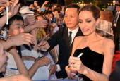 American actress Angelina Jolie gives her autogarphs to Japanese fans at the Japan premiere of their recent movie 'Maleficent' in Tokyo on June 23...