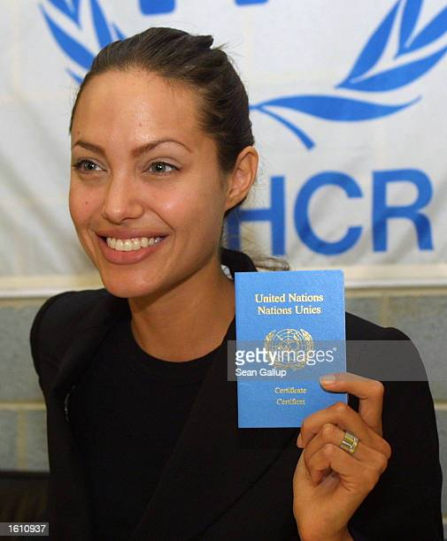 American actress Angelina Jolie holds a certificate from the United Nations High Commission for Refugees confirming her appointment as a goodwill...