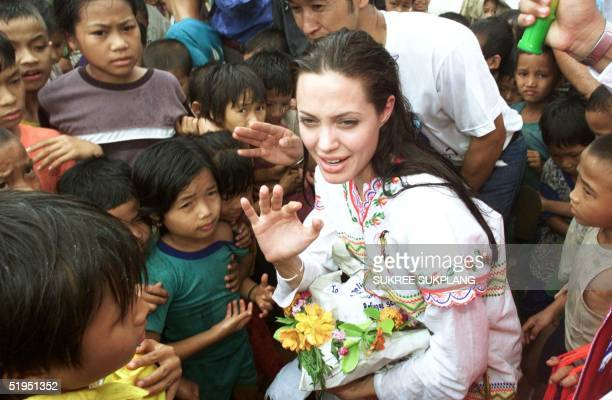 American actress Angelina Jolie receives gifts from the children at the Tham Hin refugee camp on the ThaiBurma border May 19 2002 Jolie visited the...