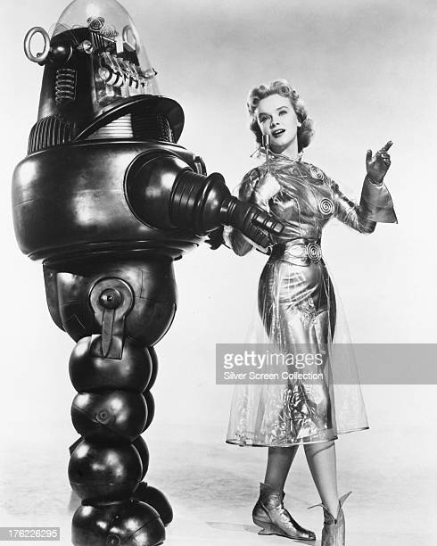 American actress Anne Francis as Altaira 'Alta' Morbius with Robby the Robot in a promotional portrait for 'Forbidden Planet' directed by Fred M...