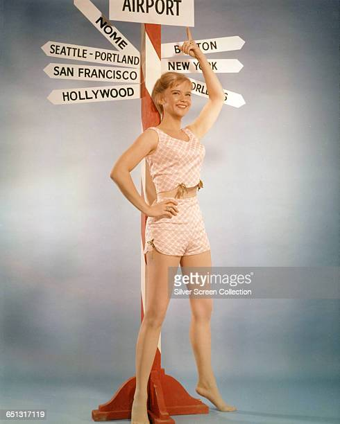 American actress Anne Francis standing next to a signpost USA circa 1955