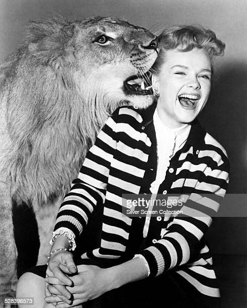 American actress Anne Francis with a lion circa 1955