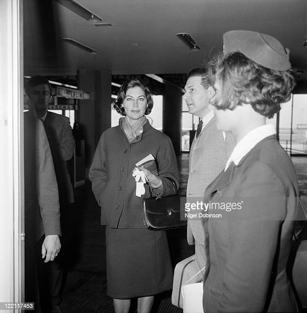 American actress Ava Gardner at an airport circa 1963 The book she is holding is 'The Feminine Mystique' by Betty Friedan