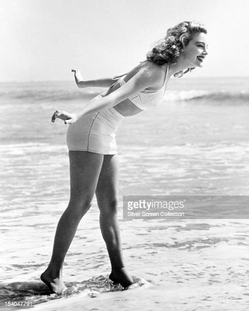 American actress Ava Gardner at the beach in a twopiece swimming costume March 1943