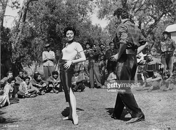 American actress Ava Gardner dances with Italian dancer Riccardo Rioli in 'The Barefoot Contessa' directed by Joseph L Mankiewicz Italy 1954