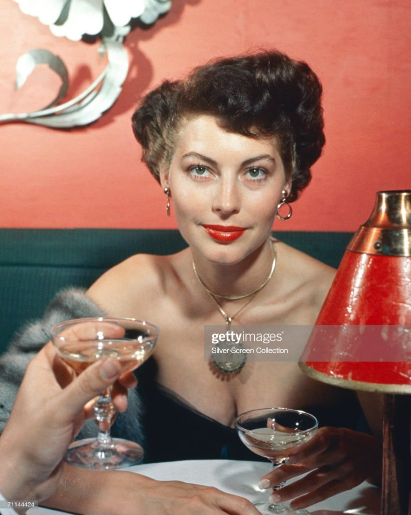 American actress Ava Gardner (1922 - 1990) seen from the point of view of her dining companion, circa 1960.