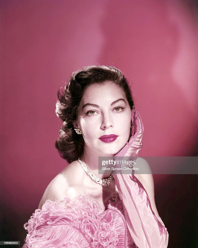 American actress <a gi-track='captionPersonalityLinkClicked' href=/galleries/search?phrase=Ava+Gardner&family=editorial&specificpeople=93109 ng-click='$event.stopPropagation()'>Ava Gardner</a> (1922 - 1990) wearing pink evening gloves, circa 1950.