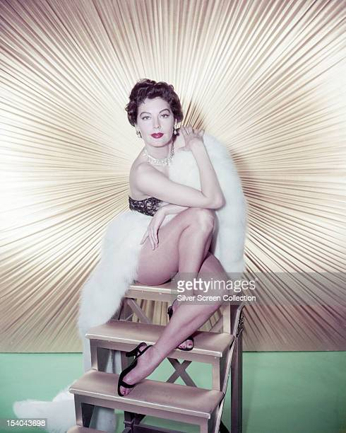 American actress Ava Gardner wrapped in a white fur stole circa 1955