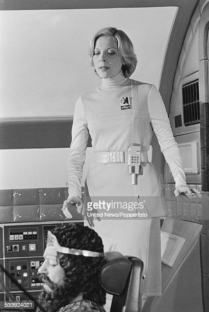 American actress Barbara Bain and English actor John Standing pictured together in character as Doctor Helena Russell and Pasc on set during filming...