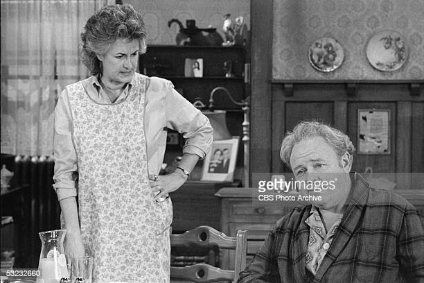 American actress Bea Arthur looks angrily at American actor Carroll O'Connor in a scene from an episode of the controversial CBS sitcom 'All in the...