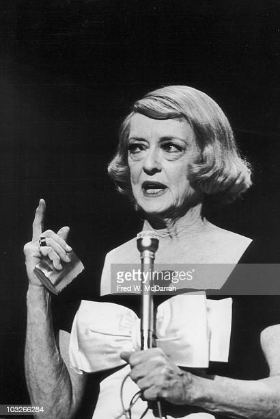 American actress Bette Davis speaks to from the stage at Town Hall as part of the Legendary Ladies of the Silver Screen lecturn series New York New...