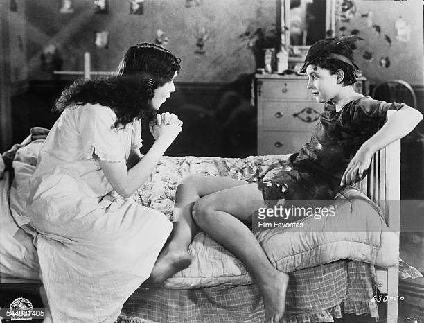 American actress Betty Bronson as the eponymous hero of the film 'Peter Pan' 1924 On the left is Mary Brian as Wendy The film was based on the play...