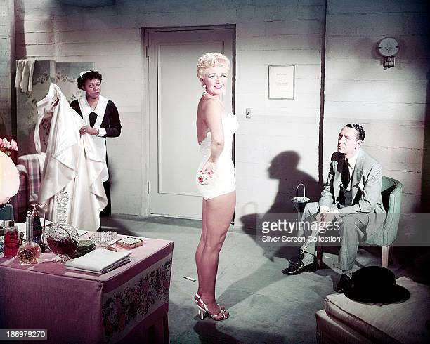 American actress Betty Grable wearing a onepiece swimsuit in a dressing room circa 1945