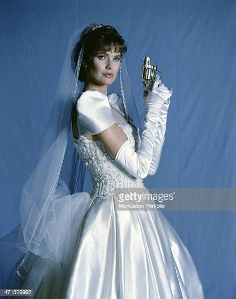 American actress Carol Alt posing as the main character of the TV miniseries Vendetta Secrets of a Mafia Bride 1989