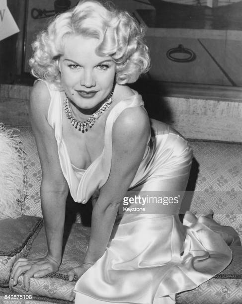 American actress Carroll Baker dressed as actress Jean Harlow upon her arrival at Southampton on the liner 'Queen Mary' 20th October 1964 She will...