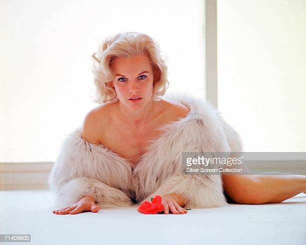 American actress Carroll Baker dressed in a fur coat and nothing else circa 1955