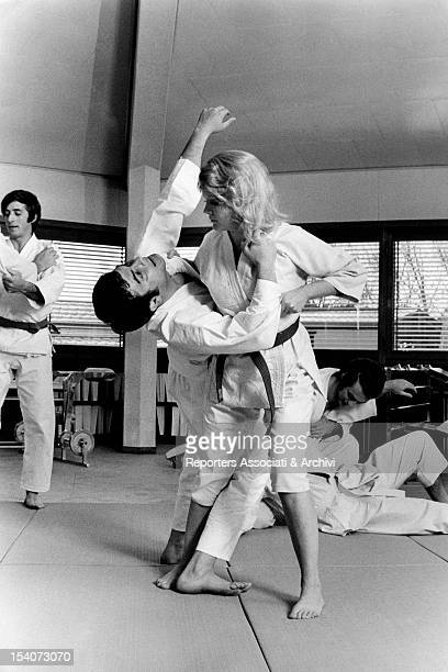American actress Carroll Baker practicing judo with her trainer Rome March 1970