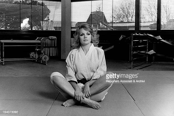 American actress Carroll Baker sitting crosslegged in her judo gym Rome March 1970