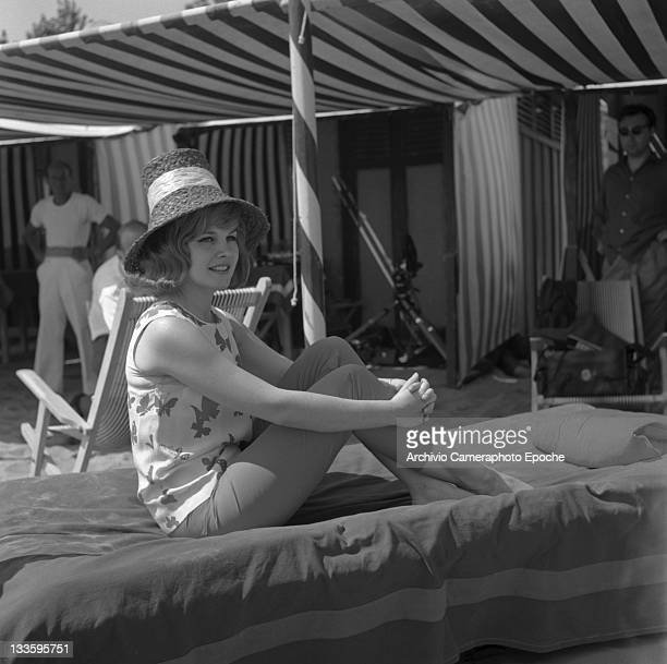 American actress Carroll Baker sitting on a sunbed on the beach Lido Venice 1961
