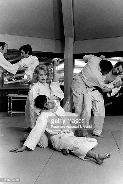 American actress Carroll Baker training for a classical judo move Rome March 1970