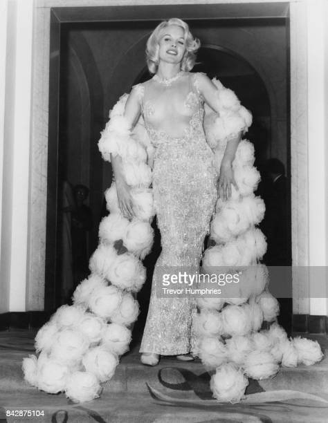 American actress Carroll Baker wears a partiallytransparent dress to the postpremiere reception for her latest film 'The Carpetbaggers' at Claridge's...