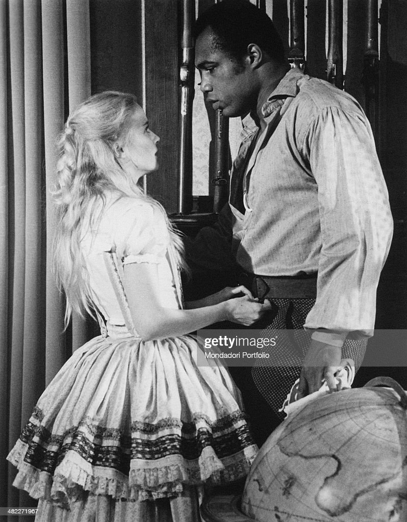 American actress Cheryl Smith and American boxer and actor Ken Norton looking in the eye in the film Drum. 1976