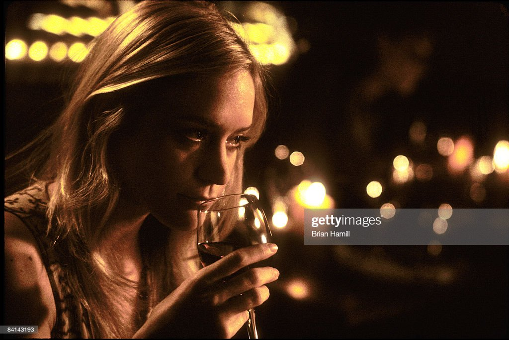 American actress Chloe Sevigny drinks a glass of wine in a scene from the Woody Allen-directed film 'Melinda and Melinda,' New York, New York, 2004.