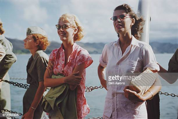 American actress Cynthia Stone and Rita Aarons wife of photographer Slim Aarons watch the filming of John Ford's 'Mister Roberts' Hawaii 1955