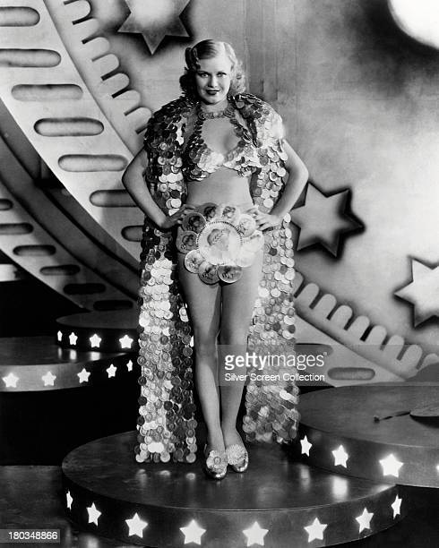 American actress dancer and singer Ginger Rogers as Fay Fortune wearing a coincape costume in a promotional portrait for 'Gold Diggers of 1933'...