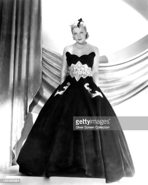 American actress dancer and singer Ginger Rogers in a dark strapless ball gown circa 1935