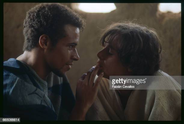 American actress Debra Winger close to actor Eric VuAn in a halflit room during the shooting of the movie Un The au Sahara or Il Te Nel Deserto...