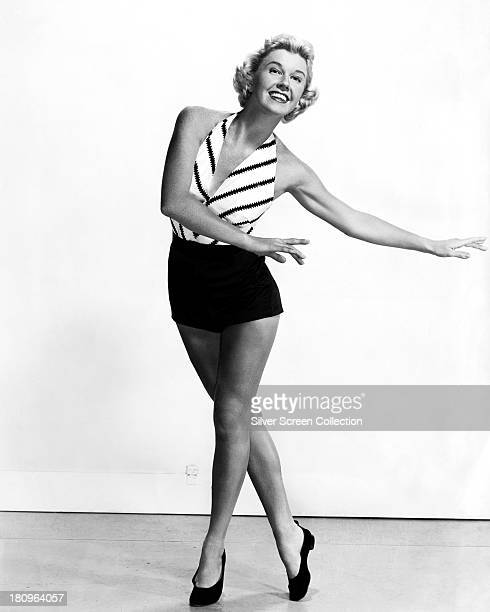 American actress Doris Day dancing in shorts and a sleeveless top circa 1955