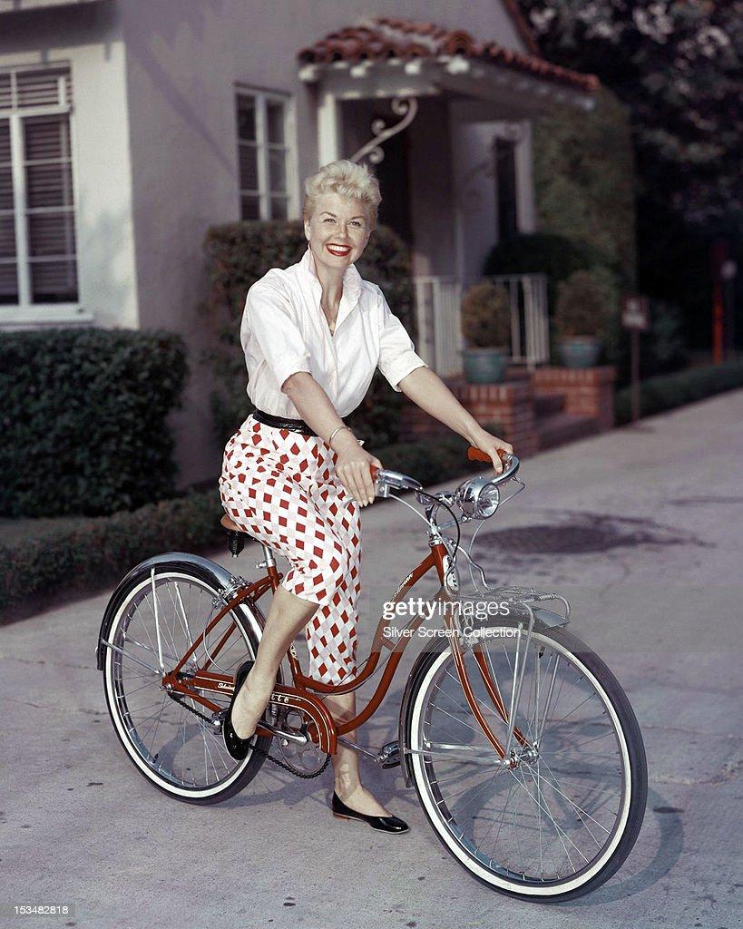 American actress Doris Day riding a Schwinn bicycle, circa 1955.