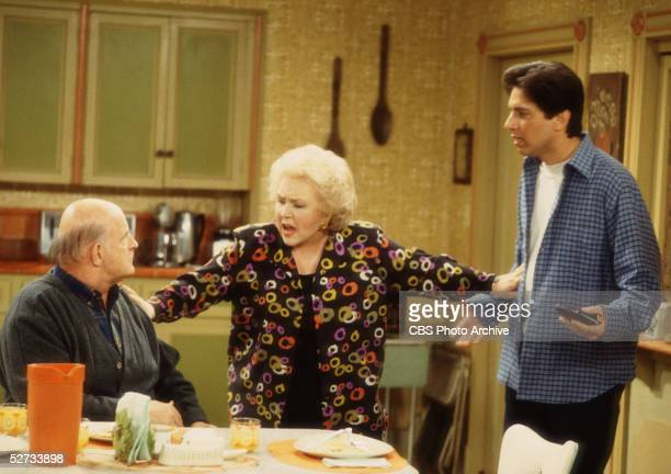 American actress Doris Roberts separates actors Peter Boyle and Ray Romano in a scene from an episode of 'Everybody Loves Raymond' entitiled 'The...