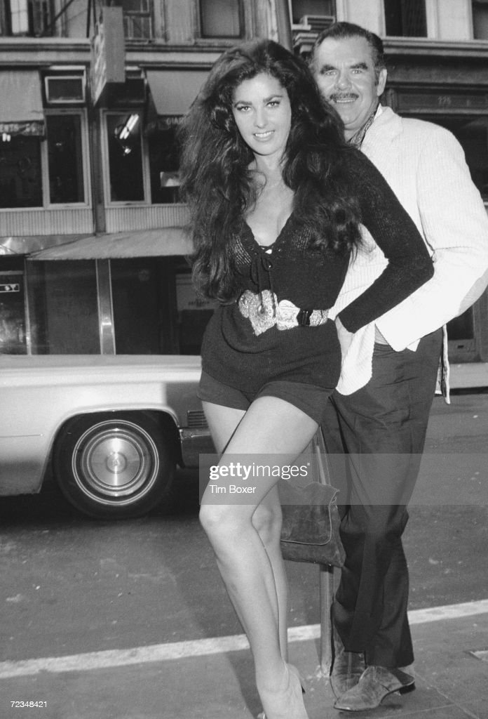 American actress Edy Williams poses with her husband, film director Russ Meyer (1922 - 2004), New York, New York, mid 1971. The couple is likely in New York for the premeire of the film 'The Seven Minutes,' starring Williams and directed by Meyer.