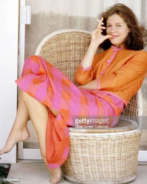 American actress Elizabeth Montgomery sitting on a wicker chair circa 1970