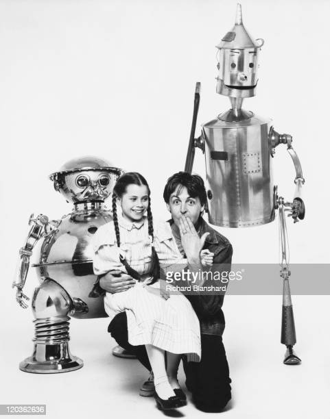 American actress Fairuza Balk poses with English singer songwriter and musician Paul McCartney as well as characters TikTok and the Tin Woodman...