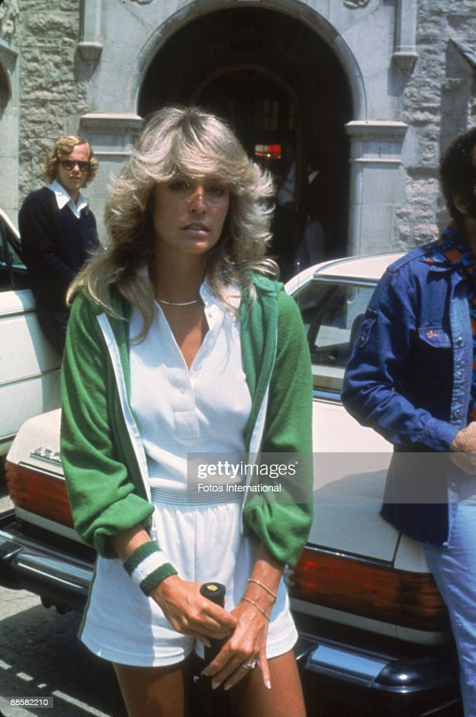 American actress Farrah Fawcett (then known as Farrah Fawcett-Majors) poses with a tennis racket outside the Playboy Mansion where she participated in a charity tennis match, Los Angeles, California, May 1976.