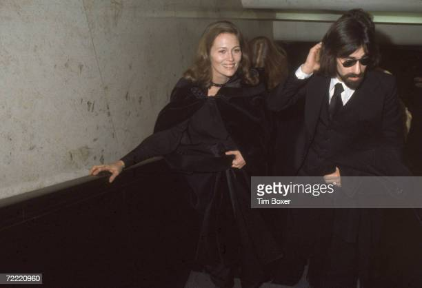 American actress Faye Dunaway and her husband rock and roll musician Peter Wolf lead vocalist for the J Geils Band walk through a hallway at the...