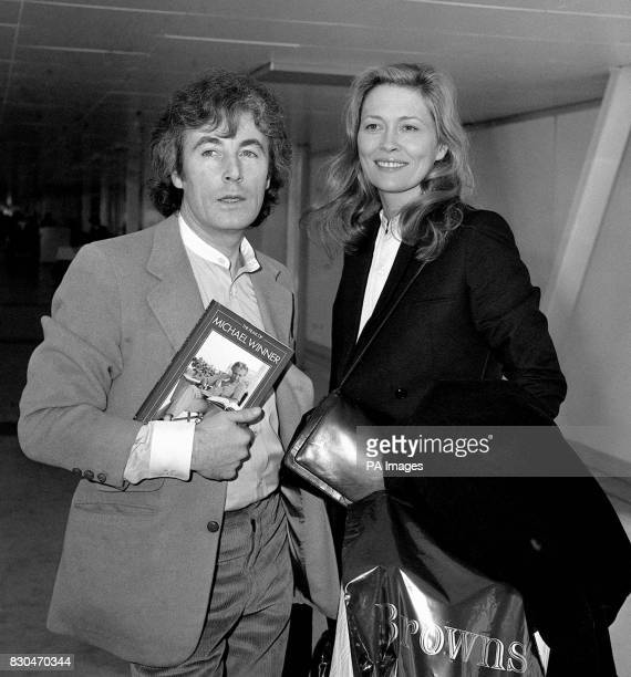 American actress Faye Dunaway and her photographer boyfriend Terry O'Neill at Heathrow airport London prior to flying out to New York